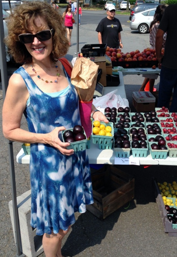 Kelley Hospitality herself checks out the plums for plum tarts.