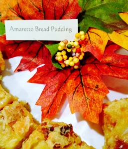 Amaretto Bread Pudding makes a lovely dessert to take to a potluck party during the holidays. Decorate the tray with the colors of the season and label it for a buffet.